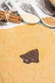 Rolled Out Gingerbread Dough With Cutting Shapes Of Christmas Decoration