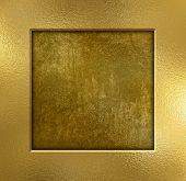 Gold metal frame on a grunge background
