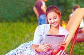 Beautiful Girl With Tablet On Summer Picnic