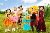 Happy children in colorful Halloween costumes