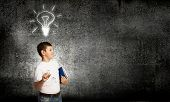 Schoolboy with books and light bulb. Idea concept