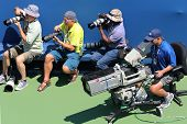 Professional photographers and TV camera man at US Open 2014 at National Tennis Center