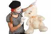 stock photo of clown rose  - Mime comedian talking with teddy bear isolated on white background - JPG