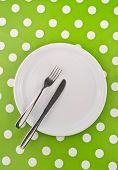 Empty White Flat Plate With Fork And Knife