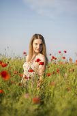 Woman At Dress Posing On Poppy Field