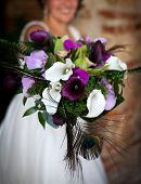 pic of female peacock  - Colorful wedding bouquet with peacock feathers - JPG