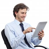 Executive Sitting On A Chair Browsing A Tablet