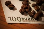 Coffee beans on bank note
