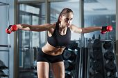 Woman Doing Workout With Barbell