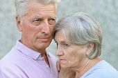 Portrait of sad mature couple