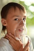 Ill boy with inhalator