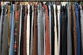 stock photo of thrift store  - A rack of mens pants in a second hand shop - JPG