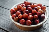 Red Gooseberries In Plate
