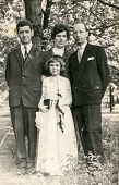 SIERADZ, POLAND - CIRCA 1950: Vintage photo of grandfather, parents and little girl at her First Com