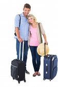 Attractive young couple ready to go on vacation on white background