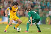 VIENNA, AUSTRIA - AUGUST 8 Brian Behrendt (#3 Rapid) and Sebastian Grazzini (#10 Asteras) fight for