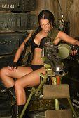 Brunette woman with machine gun