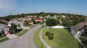 stock photo of middle class  - Suburban middle class homes in Florida aerial view - JPG