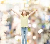 happiness, freedom, future concept - smiling teenage girl in with raised hands