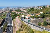 Aerial View Of Funchal And Highway, Build Against The Mountains Of Madeira Island