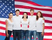 advertising, friendship, patriotism and people concept - group of smiling teenagers in white blank t