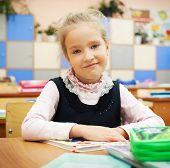 Girl at classroom. Children at school