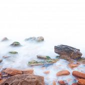 Shore of the sea, rocks and flowing water. Isolated with white background