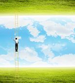 Rear view of businessman climbing ladder between two realities