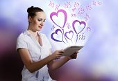 Young woman using holding tablet pc. Romance concept