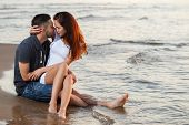 stock photo of couple sitting beach  - Summer - JPG