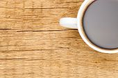 White Ceramic Coffee Cup On Wooden Table