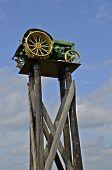 John Deere tractor perched on wood pilings