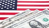 Dollar notes on US flag