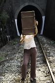 Woman And Vintage Suitcase On Railway Road