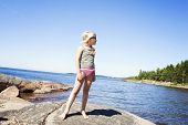 Child On Rocky Beach In Sweden
