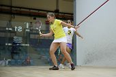 AUGUST 19, 2014 - KUALA LUMPUR, MALAYSIA: Tesni Evans (front) hits a return in her match against Raneem El Weweily in the CIMB Malaysian Open Squash Championship 2014.