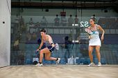 AUGUST 19, 2014 - KUALA LUMPUR, MALAYSIA: Amanda Sobhy of USA (blue shorts) plays Samantha Teran of Mexico in a match in the CIMB Malaysian Open Squash Championship 2014.