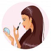 Beautiful female doing make-up
