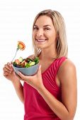 Portrait of Woman enjoying a healthy salad bowl isolated on white background