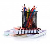 Colorful pencils and notepads. Isolated on white background