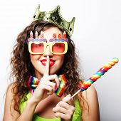 young lovely woman with crown and funny sunglasses