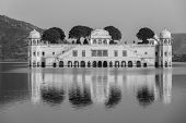 Rajasthan landmark - Jal Mahal (Water Palace) on Man Sagar Lake on sunset.  Jaipur, Rajasthan, India. Black and white version