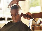 pic of barber  - little boy getting his head shaved by barber - JPG