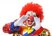 stock photo of harlequin  - Portrait of a screaming clown isolated on white background - JPG