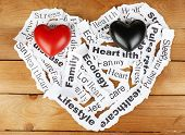 Decorative hearts on paper notes, on wooden background