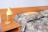 stock photo of motel  - bed in motel room  - JPG