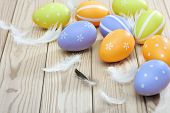 Colorful Easter Eggs And Plumelets On Wooden Background