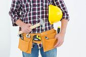 Cropped image of male repairman with hard hat and hammer on white background
