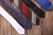 Different Ties on wooden planks background