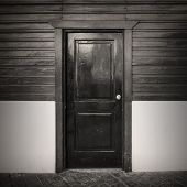 Old Wooden Door. Vintage Sepia Toned Photo